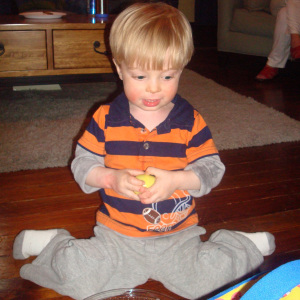 """When a child w-sits he spreads his hips with his bottom on the floor, his knees bent, and his feet behind him, making a """"W"""" shape with his legs."""